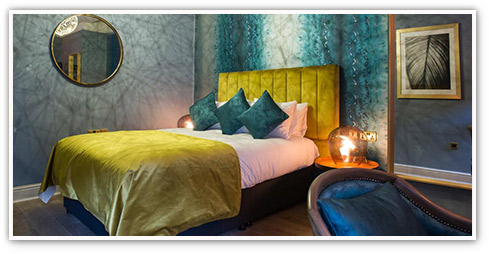 Chic and tranquil hotel room with double bed, vibrant furnishings and linens