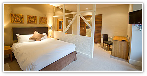 Contemporary Innkeeper's Lodge double room prepared with care for a new guest