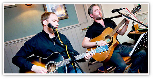 Guitar duo whipping up a great atmosphere in an O'Neill's pub - enjoy the craic