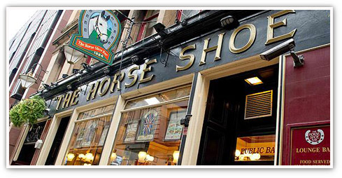 Exterior angled shot of The Horseshoe Bar - a landmark pub in Glasgow