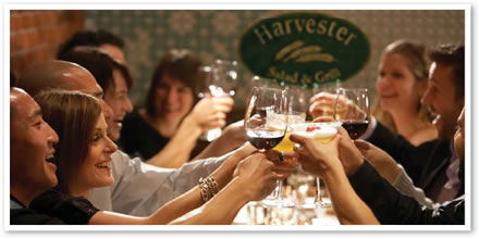 A photograph of customers toasting at a Harvester